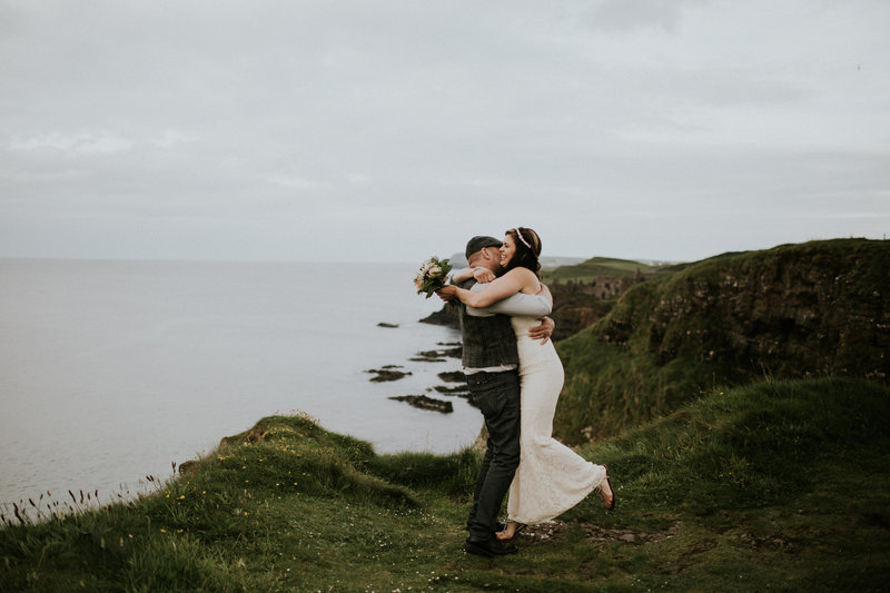 Northern Ireland Cliff Elopement Wedding Couple Embracing
