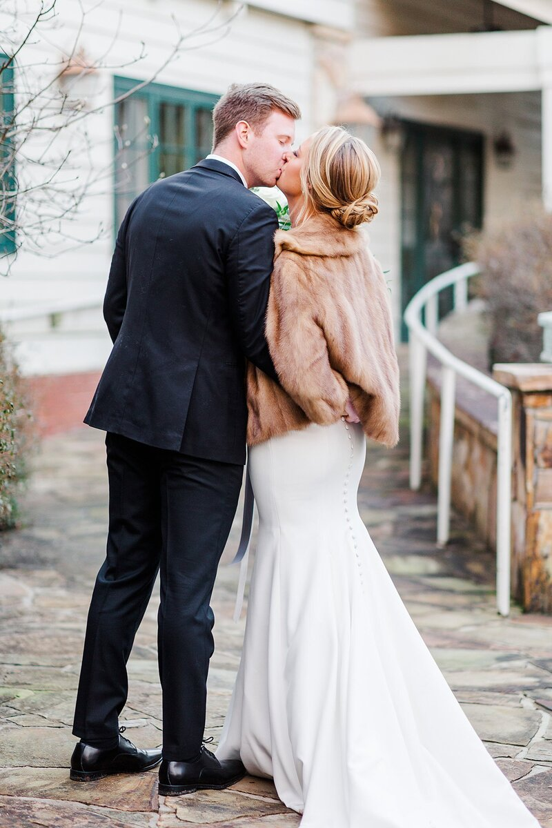 bride wearing faux fur cape by Knoxville Wedding Photographer, Amanda May Photos