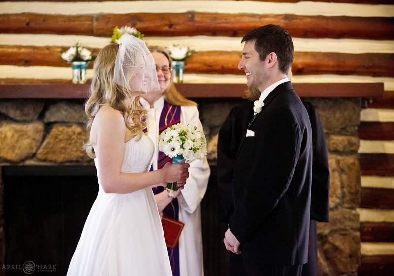 Indoor wedding ceremony on a cold spring day at The Inn at Hudson Gardens