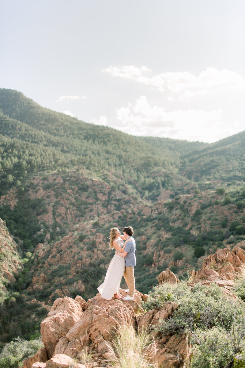 couple standing on cliff edges
