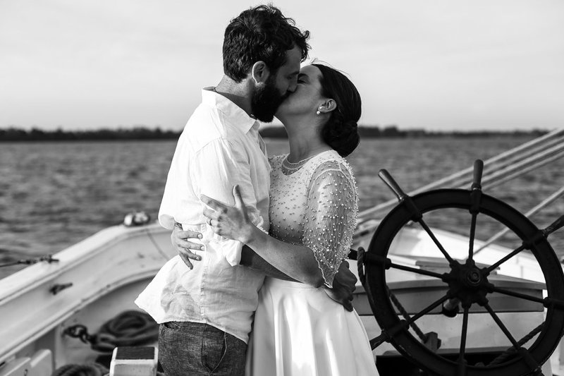 Bride and groom share first kiss on the Lettie G Howard in Erie PA