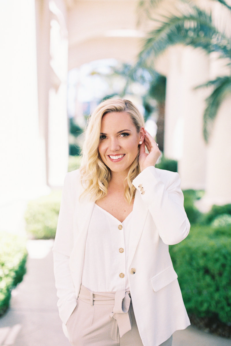 Ashley Thompson of Ashley Creative Events headshot in a garden setting with pretty vines