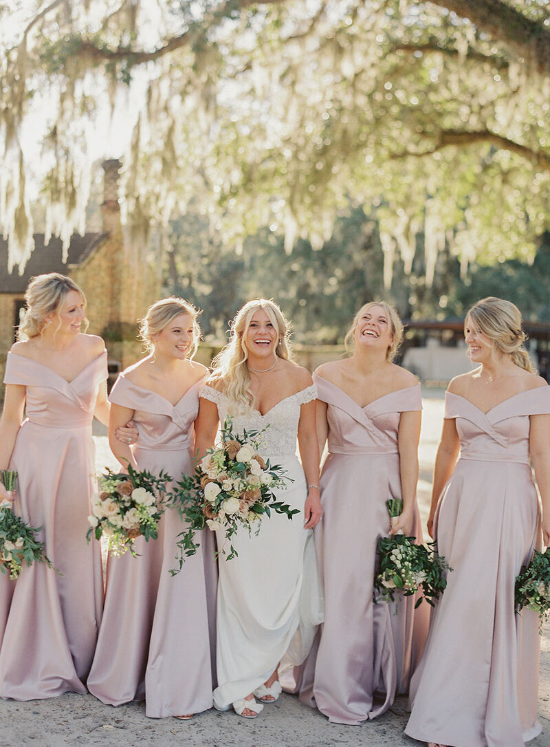 Off the shoulder bridal gown and blush off the shoulder bridesmaid dresses for a Southern wedding at Middleton Place