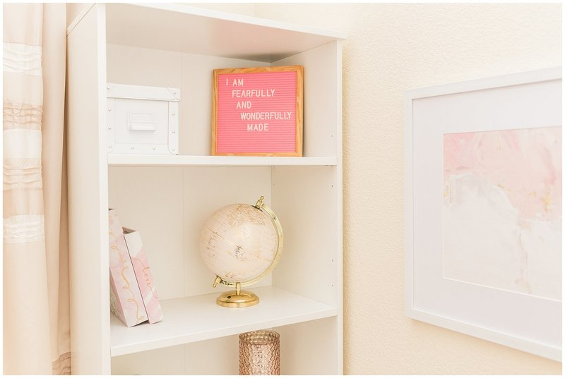 Ikea book shelf | book shelf decorated with pink and gold globe, letterboard, books, and vase