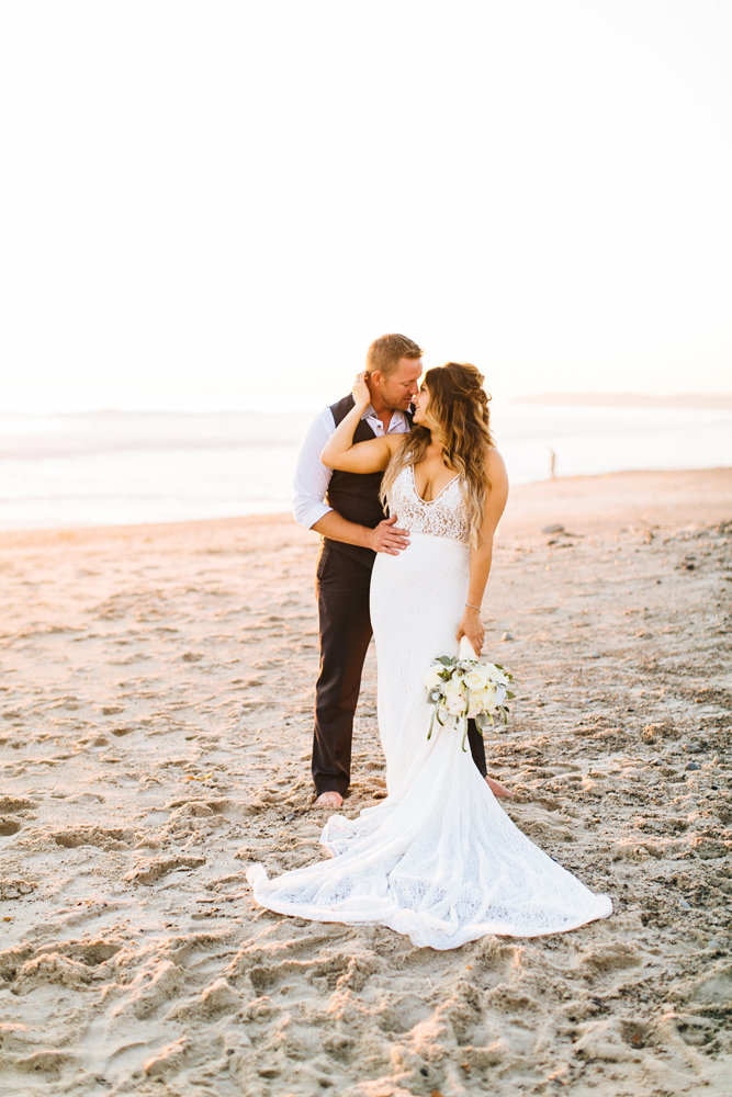 wedding at ole hanson beach club in san clemente bride and groom at sunset on the beach