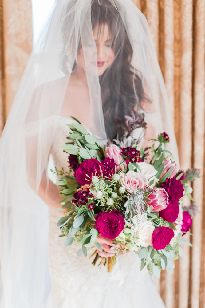 bride holding bouquet at great marsh estate wedding in northern virginia by costola photography