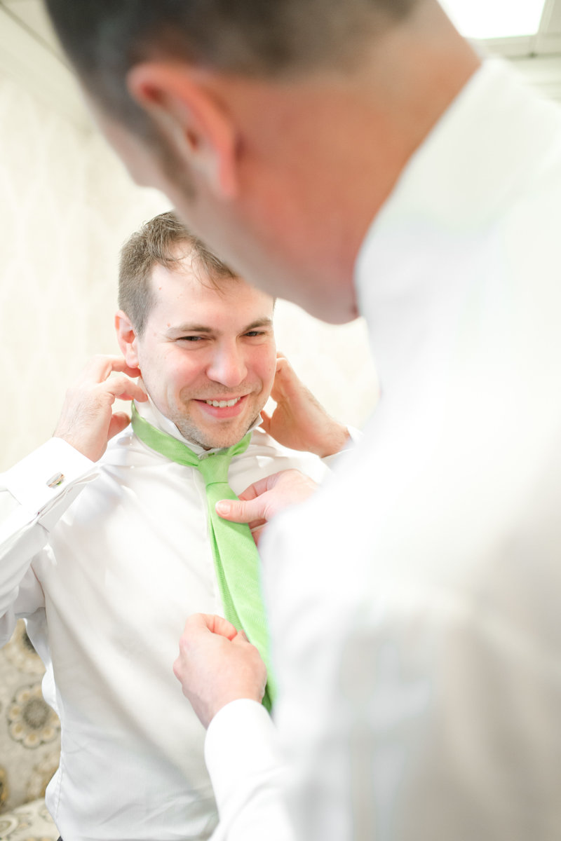 Groom getting ready at Molly Pitcher Inn