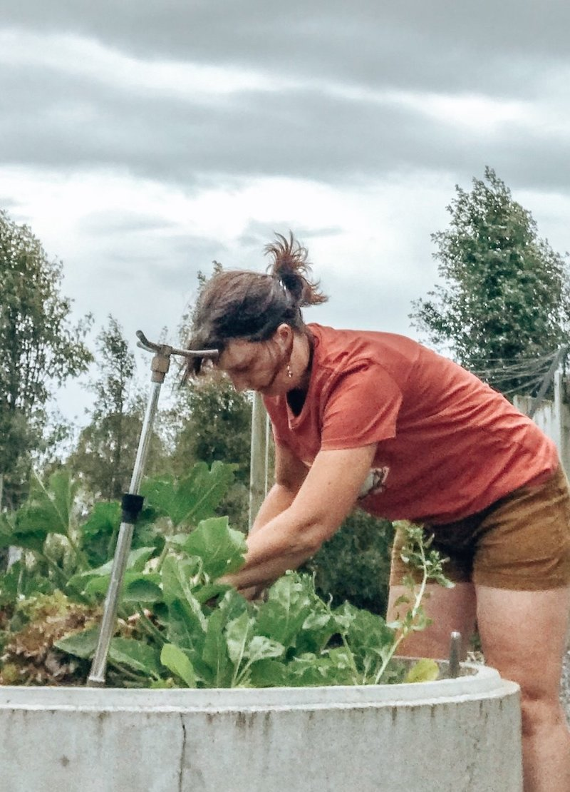 Lynda in vegetable garden, Invercargill, New Zealand