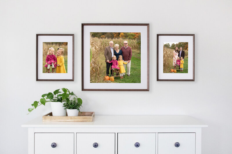 Dining room table with set of 3 photos on the wall behind it