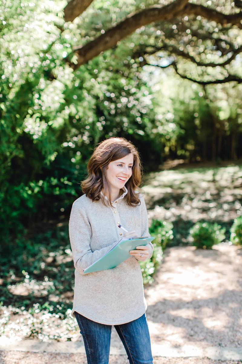 Refine's Amber Anderson taking notes and smiling outdoors
