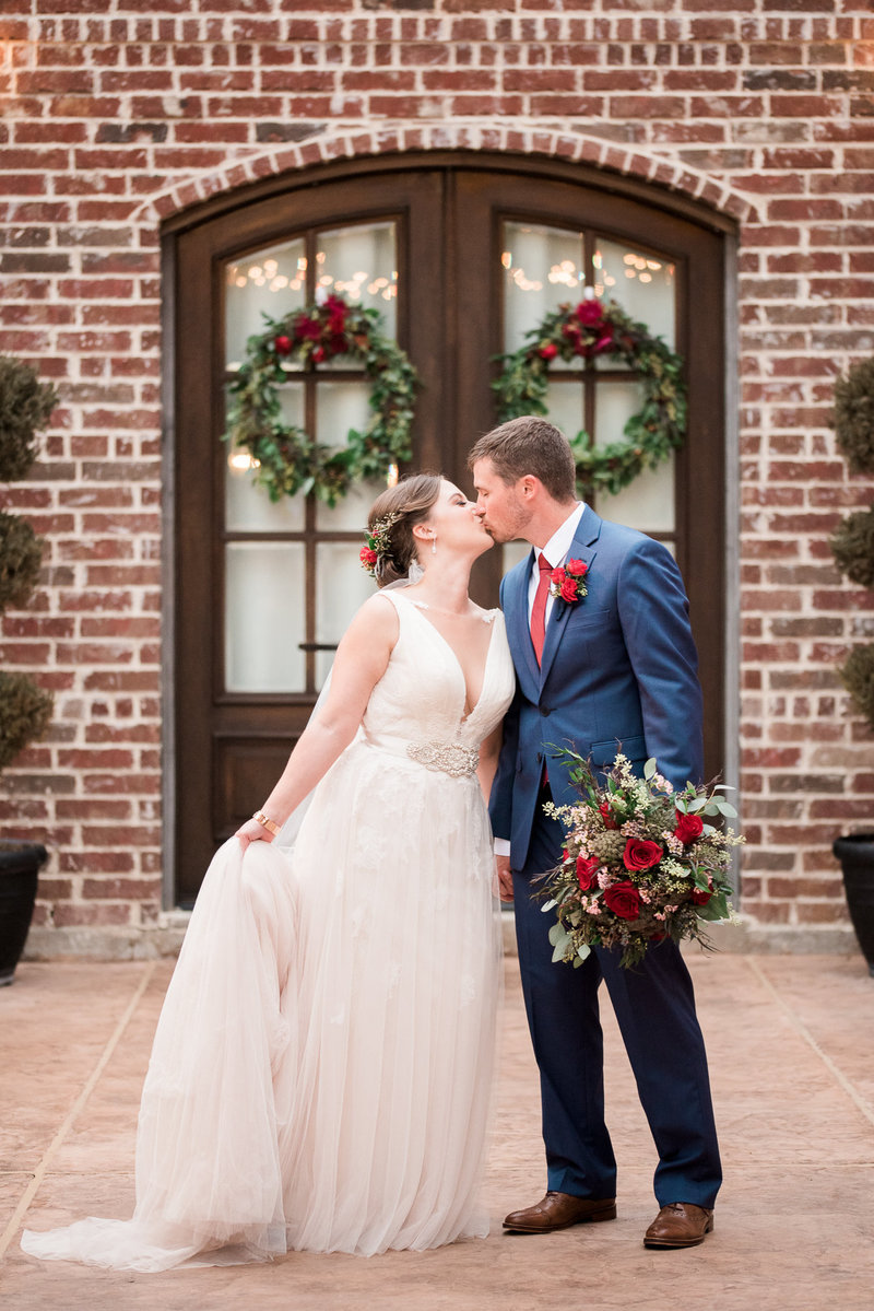 Bride and groom kiss at La Cour Venue