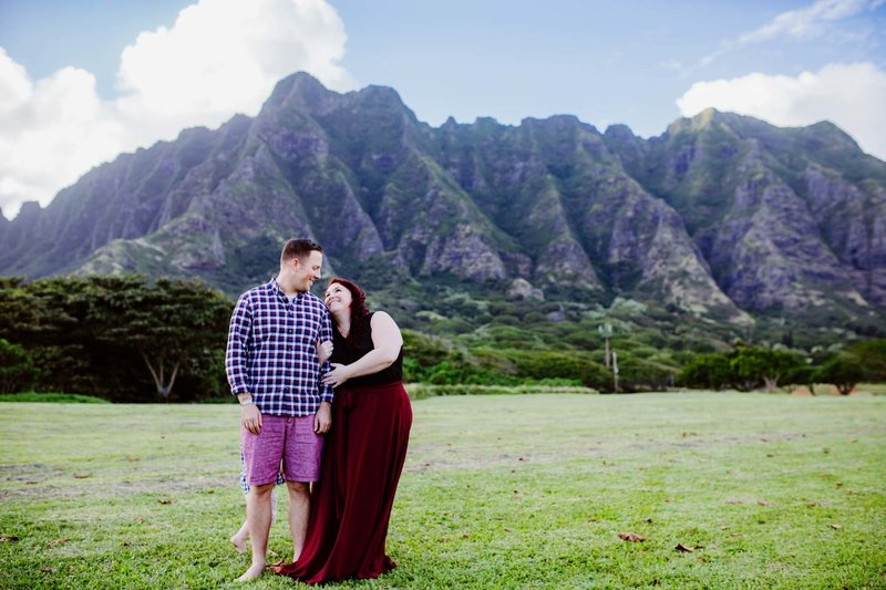 Couples Photography Oahu Hawaii,  couple standing in the grass next to a mountain