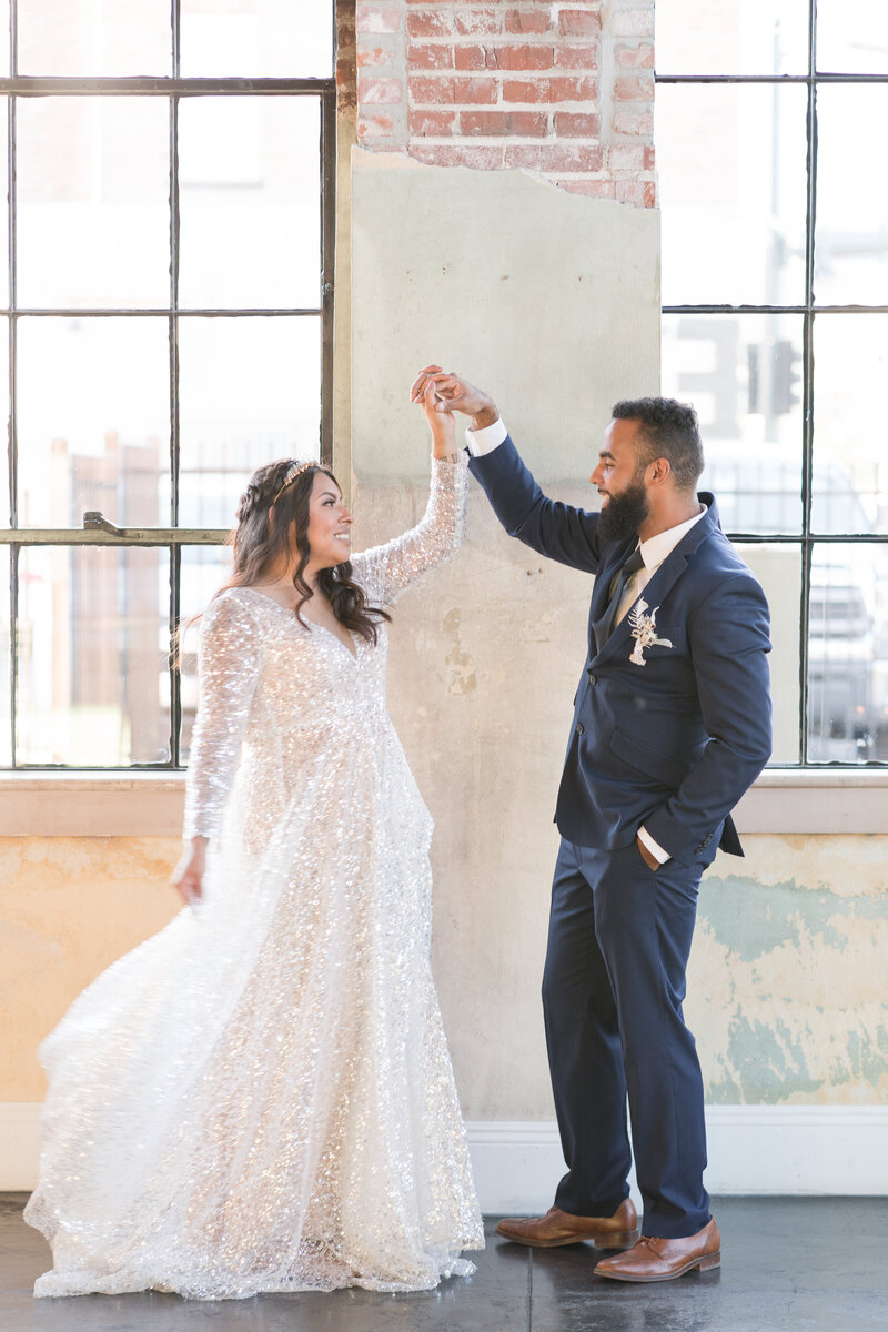 a bride and groom pose for photos at their vintage inspired sacramento wedding.