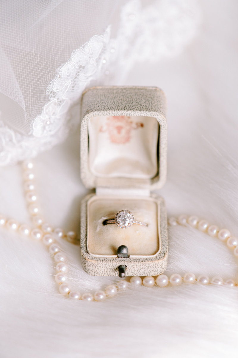 engagement ring in vintage ring box with pearls