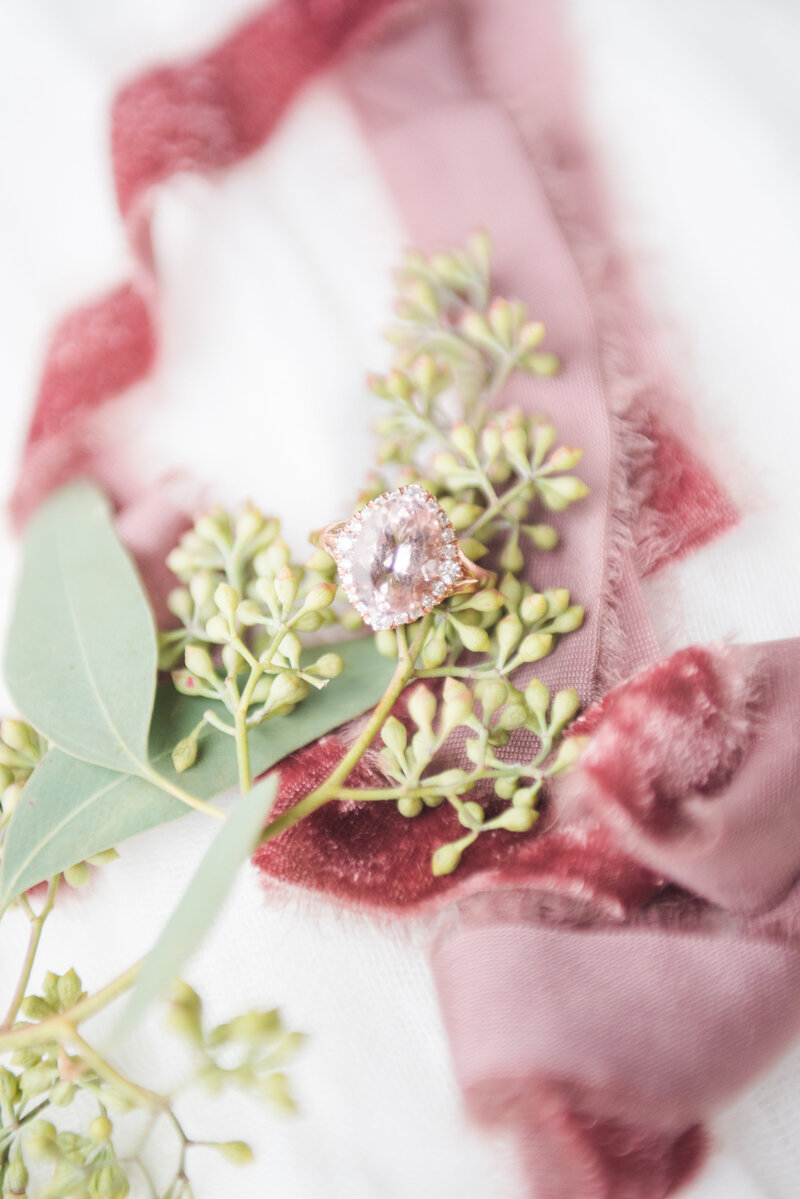 wedding ring on silk ribbon with eucalyptus leaves