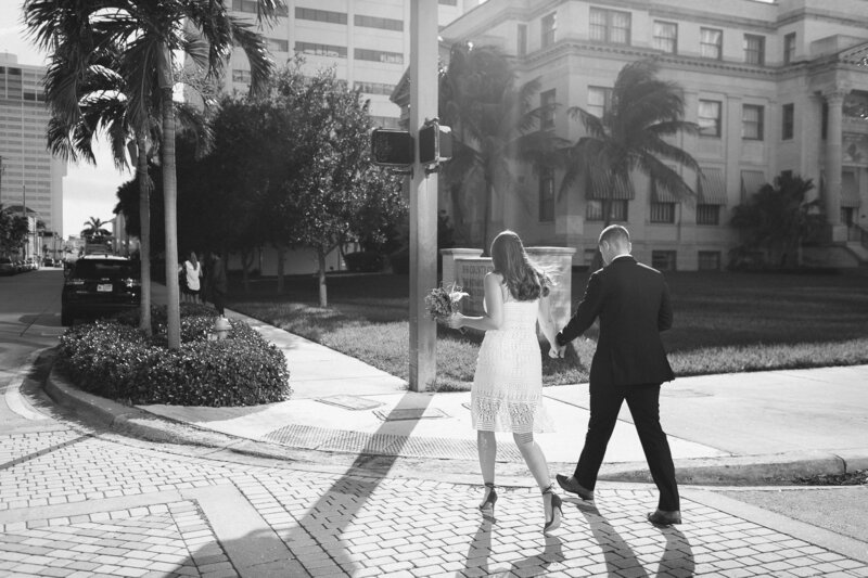 bride and groom exit their elopement ceremony at the Palm Beach courthouse