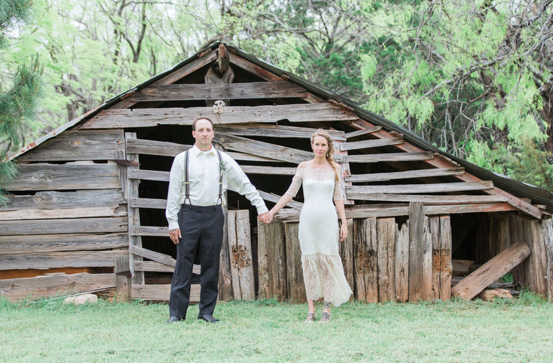 Couple in front of old building on wedding day
