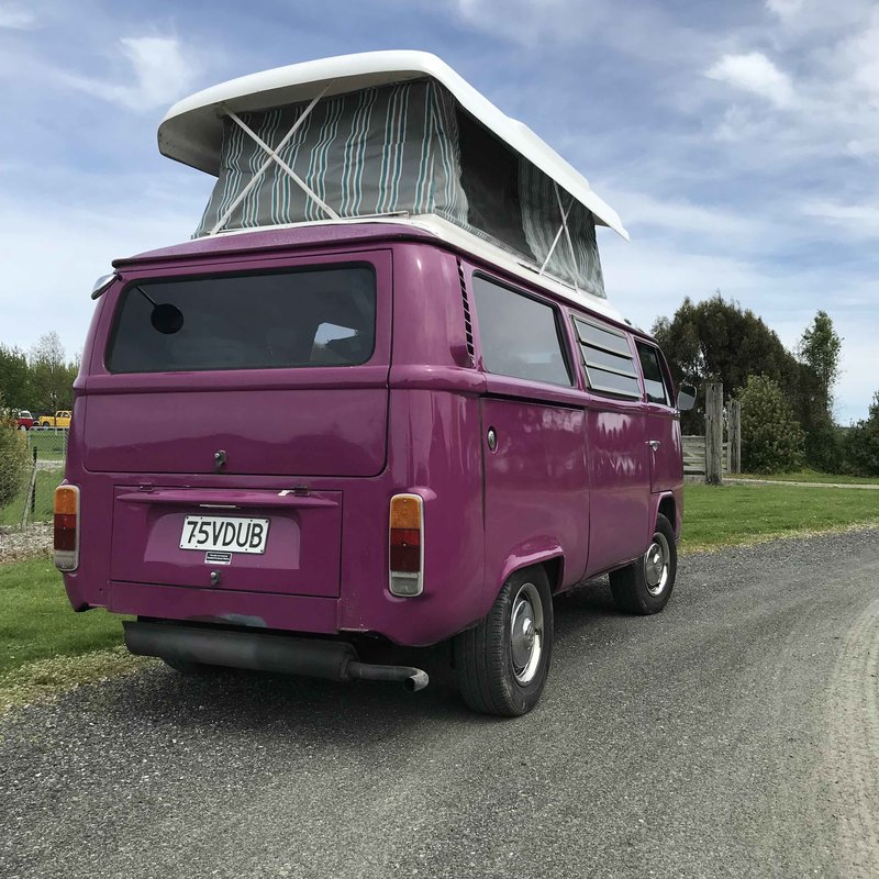 Outside view of pop top extended of Pippi, purple retro kombi van from NZ Kombi Hire