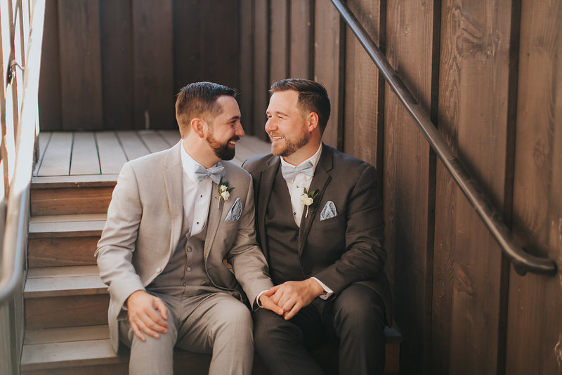 Same sex couple married at a winery in the summer.