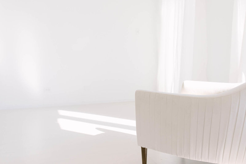 photo of Laurie Baker's natural light photography studio, all white room with white floors and white walls
