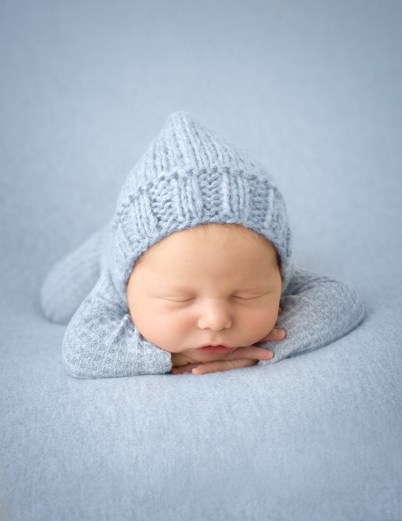 Precious newborn baby boy posed at our studio in Rochester, Ny.