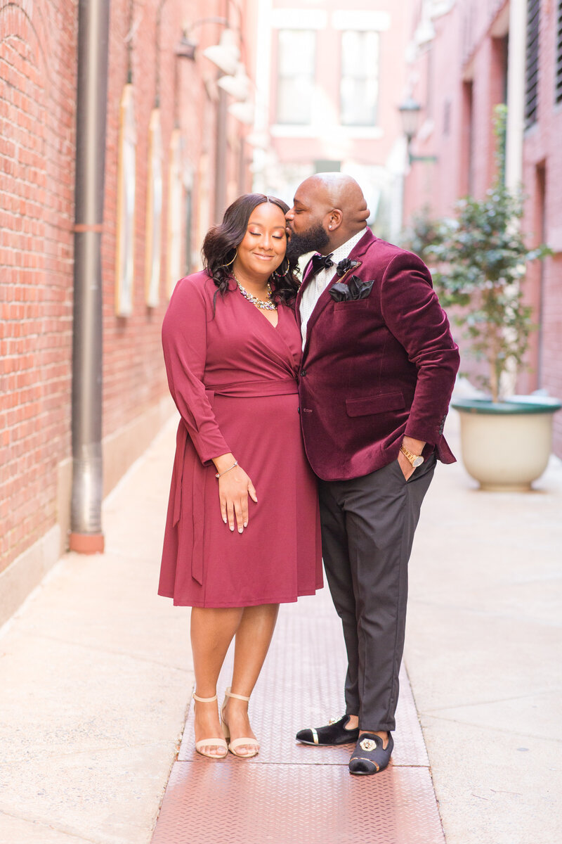man and woman in burgandy during their downtown memphis engagement session