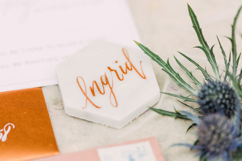Ingrid custom calligraphy name on marble hexagon