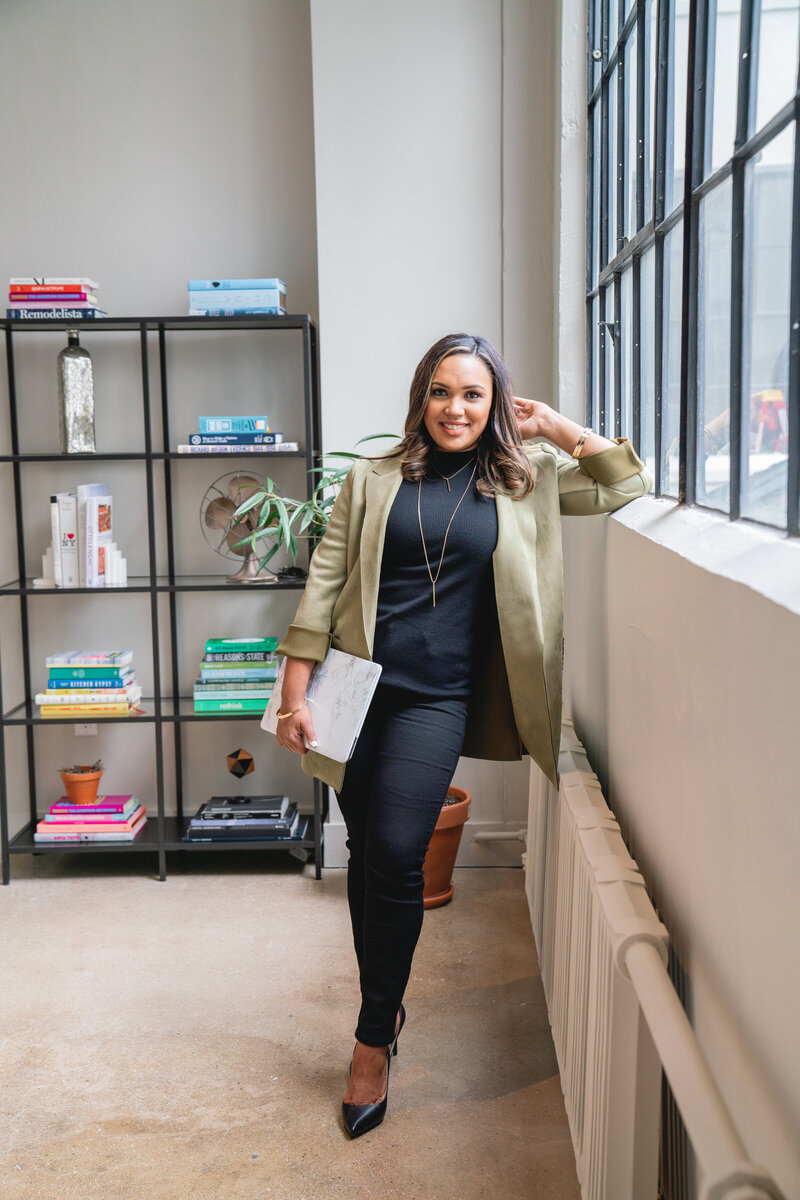 Rossalvi Marte standing in her office and smiling