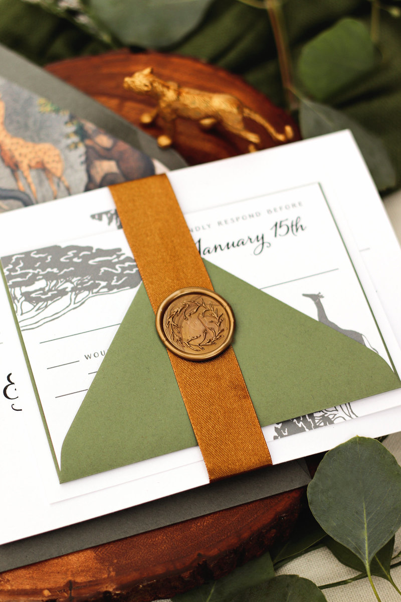 Zoo safari Wedding invitation showing the silk ribbon belly band with wax seal
