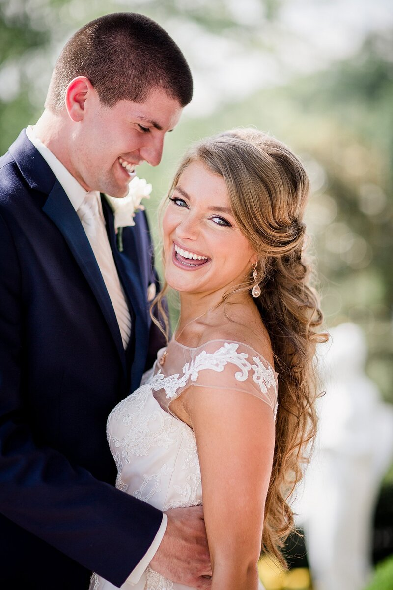 Smiling couple by Knoxville Wedding Photographer Amanda May Photos