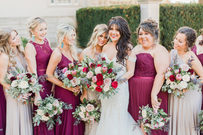 bridesmaids in wine dresses laughing at great marsh estate wedding in northern virginia by costola photography