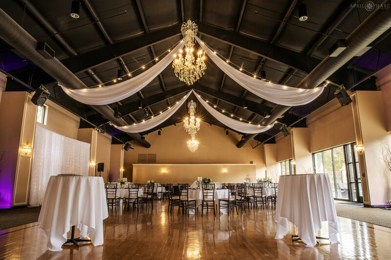 View of the interior of the large modern ballroom set up for a small wedding at Wedgewood Weddings Black Forest