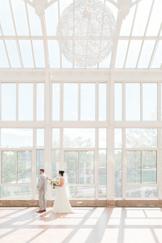bride and groom sharing first look  at Stone House at Stirling Ridge Maryland Wedding by  Costola Photography