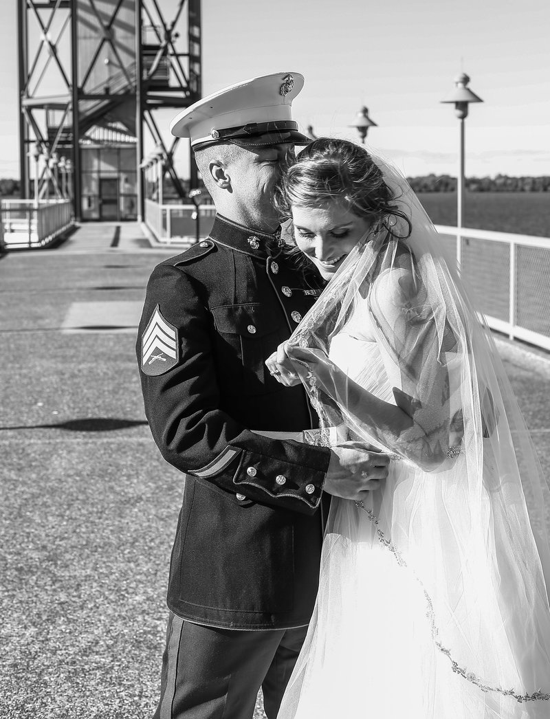 Bride and groom laugh together in front of Bicentennial Tower on Dobbin's Landing in Erie, PA