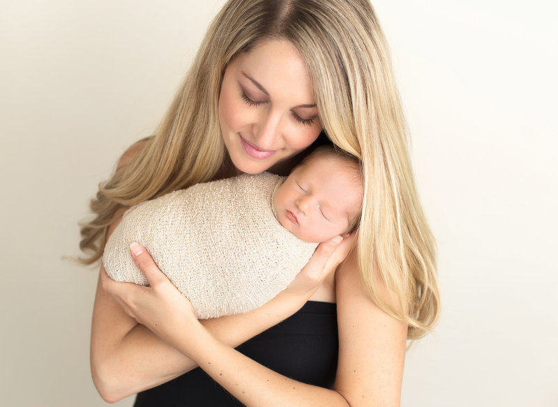 blonde mom with baby