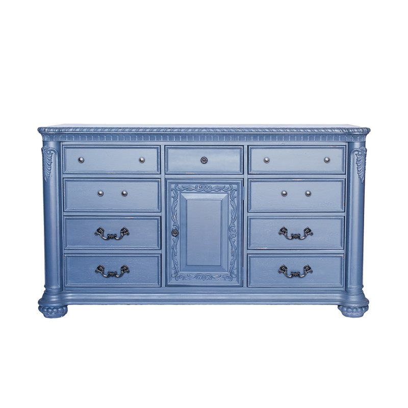 Tall, dark steel blue dresser with ornate details and light distressing.