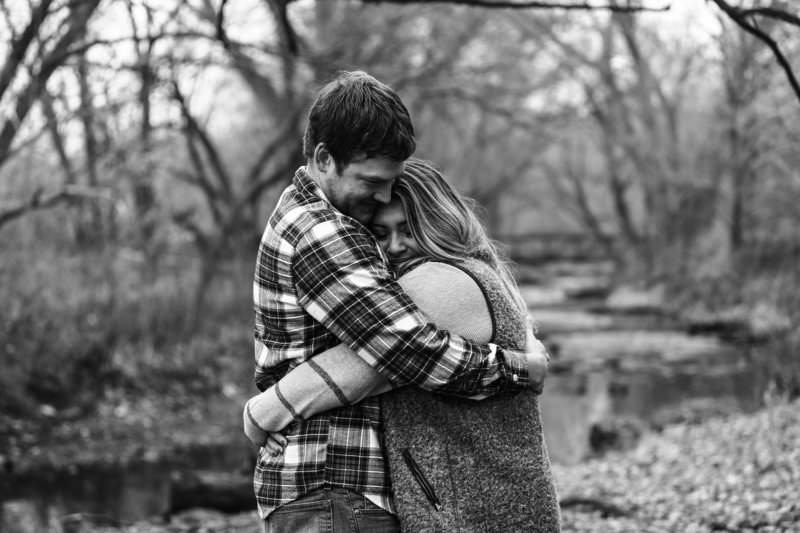 Engaged couple embraces during fall engagement photo session at Frontier Park in Erie, PA