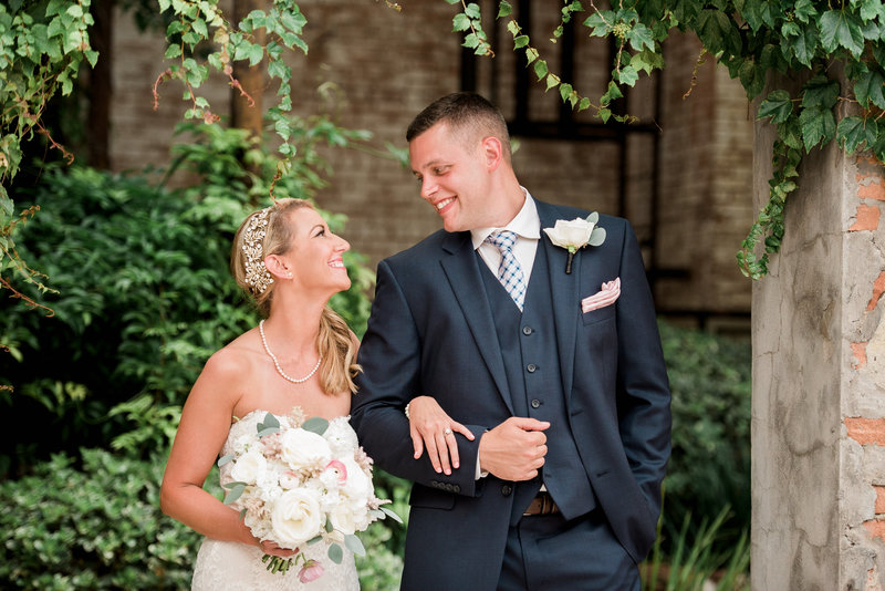 Couple posing at McKinney Cotton Mill wedding