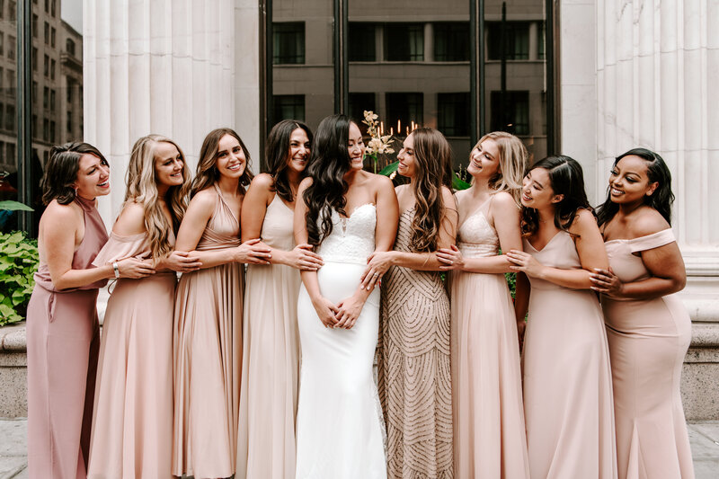 bride standing with bridesmaids