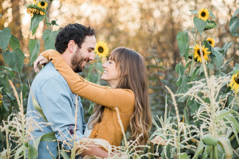 Red Deer Photographers-Raelene Schulmeister Photography- engagement photos-garden engagement -sunflowers-engagement photos in the fall