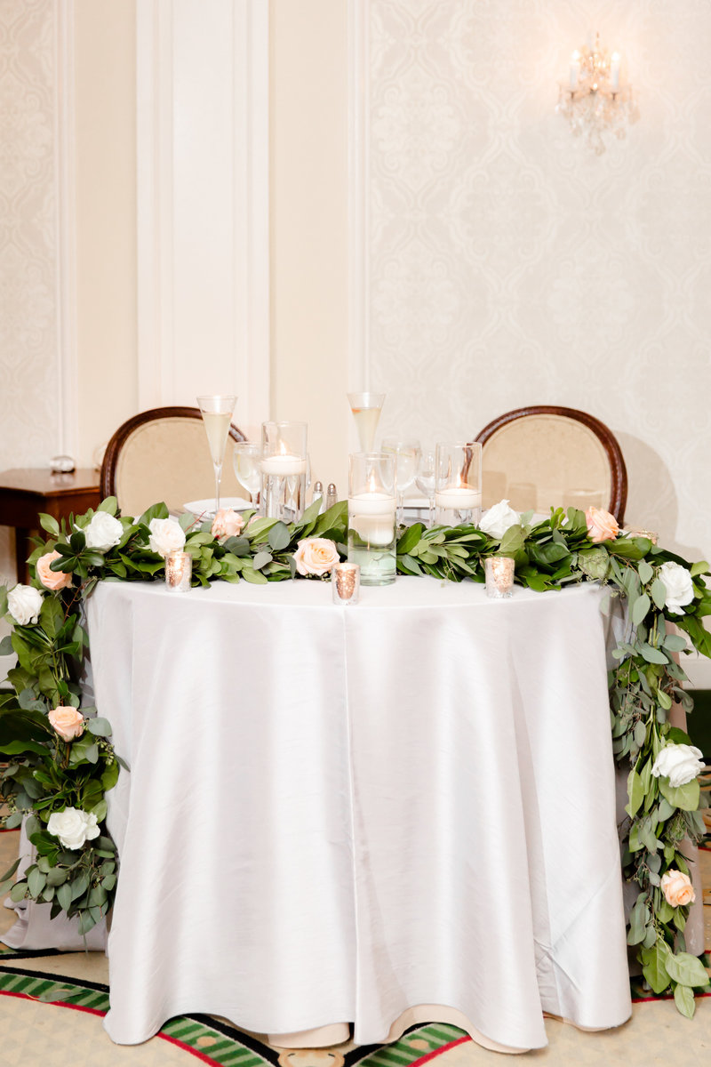 Floral garland on sweetheart table at Molly Pitcher Inn