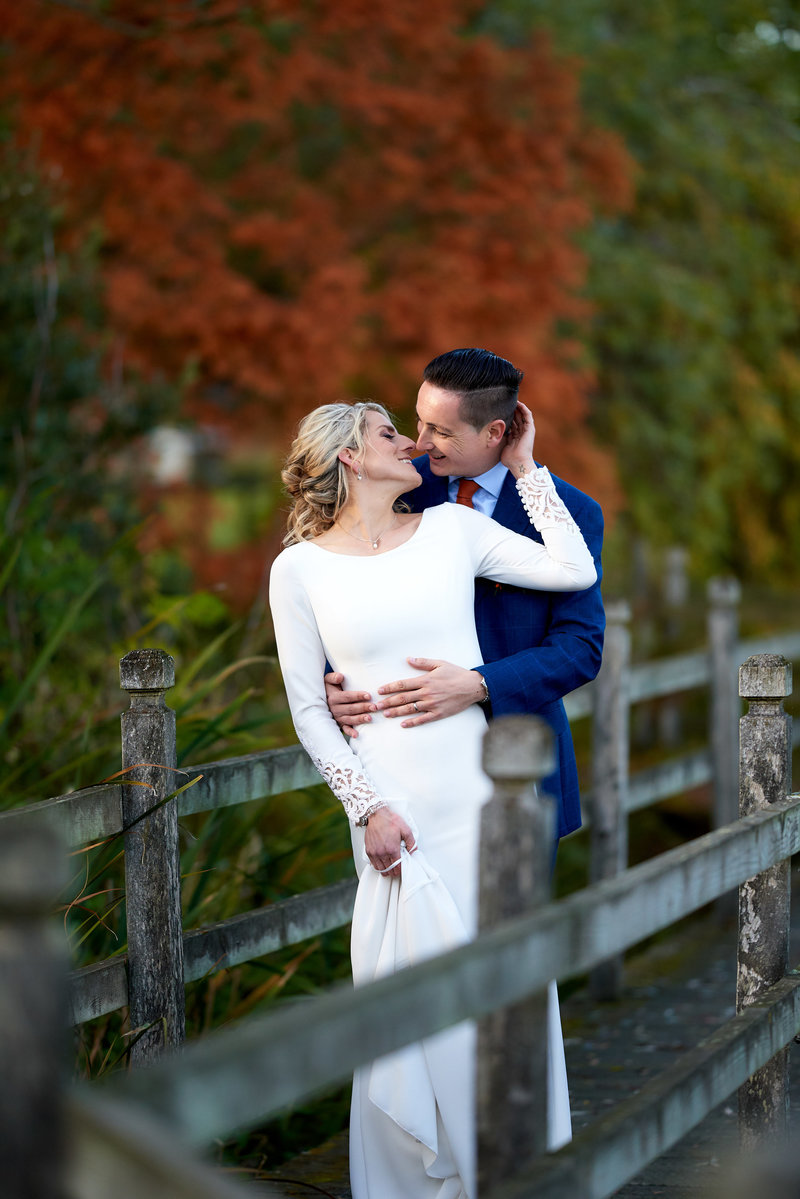 Bride and groom share a loving moment together at layer marney tower wedding venue in colchester, essex