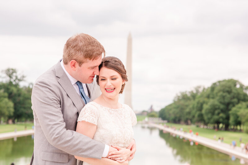 A bride and groom in front of the Washington Monument at the National Mall in Washington DC at their first look before their wedding.