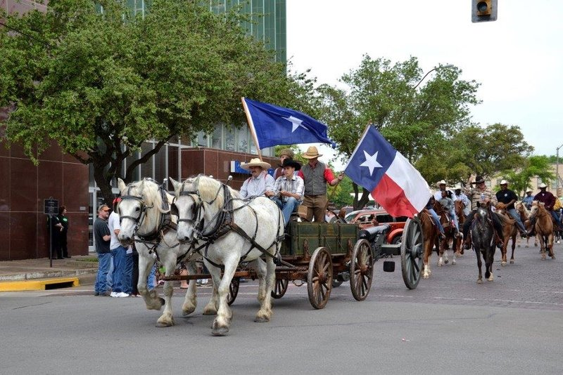 Derrick Days Parade with Texas flags