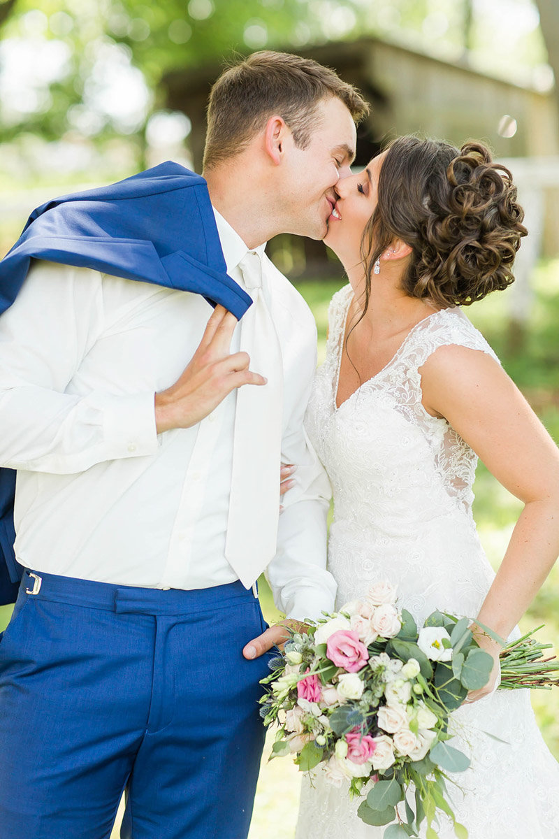Bride and Groom kissing on wedding day at Encore Hall in Berlin Ohio