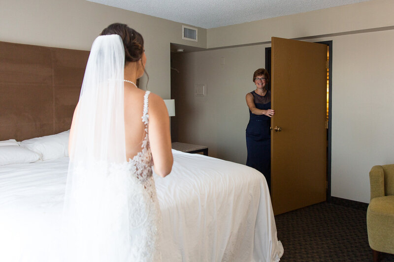 bride seeing father for first time in a detroit catholic wedding