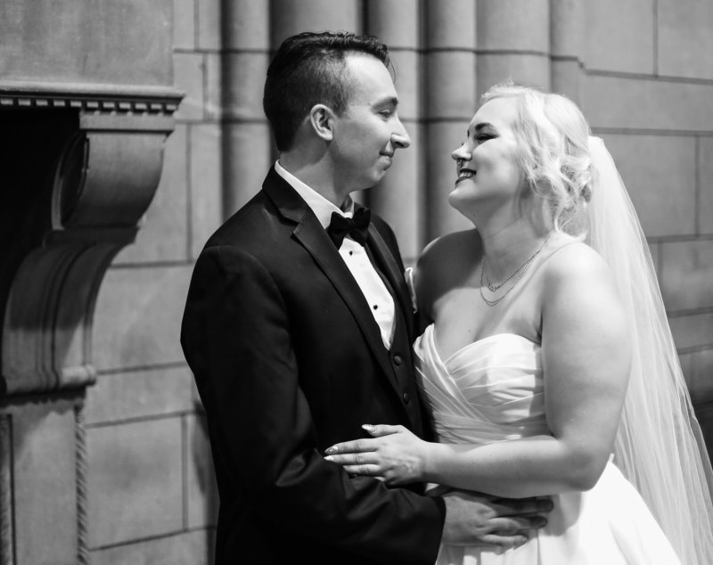 Groom smiles at his bride after first look at Cathedral of Learning in Pittsburgh, PA