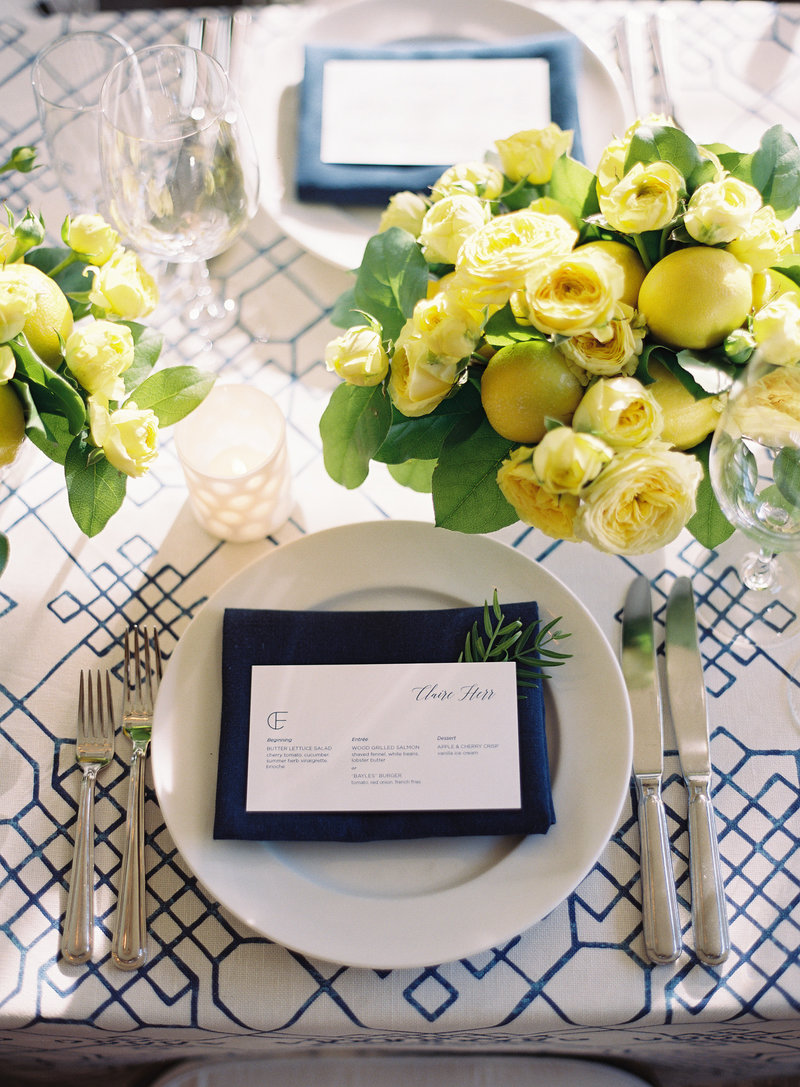 Tablescape and lemon centerpieces for rehearsal dinner by Jenny Schneider Events at Brix Restaurant in Napa Valley, California. Photo by Eric Kelley Photography.