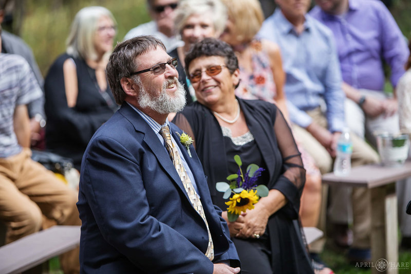 Guests-on-Benches-at-Outdoor-Colorado-Mountain-Ceremony-at-Beaver-Ranch