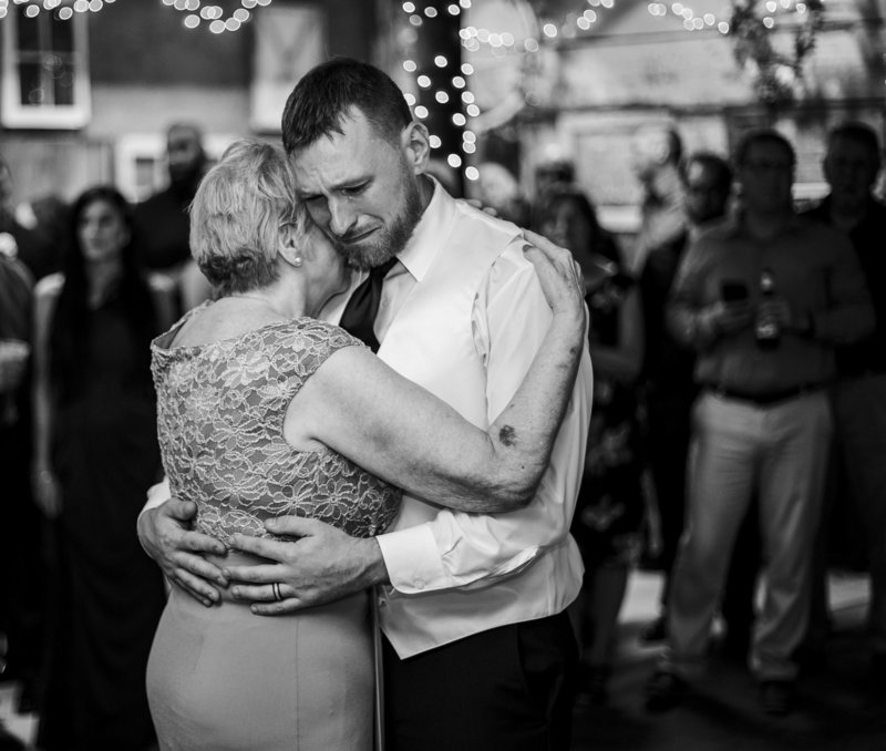 Groom cries as he shares dance with his mom at Barn at Conneaut Creek Wedding